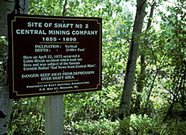 "This sign was erected to mark the spot where the tragedy occured that sparked the poem, ""Sad News from Central Mine."