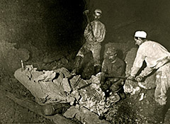 Two of these miners are each swinging an 8 pound sledge hammer while the third is holding a chisel as they attempt to cut a large mass of copper. As can be seen on the left of the photo, all of their work would have been done by candlelight. (KNHP)