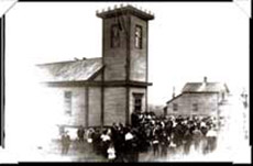 A 1912 Reunion photo showing the church where classes were held before the new school as built. (KCHS)